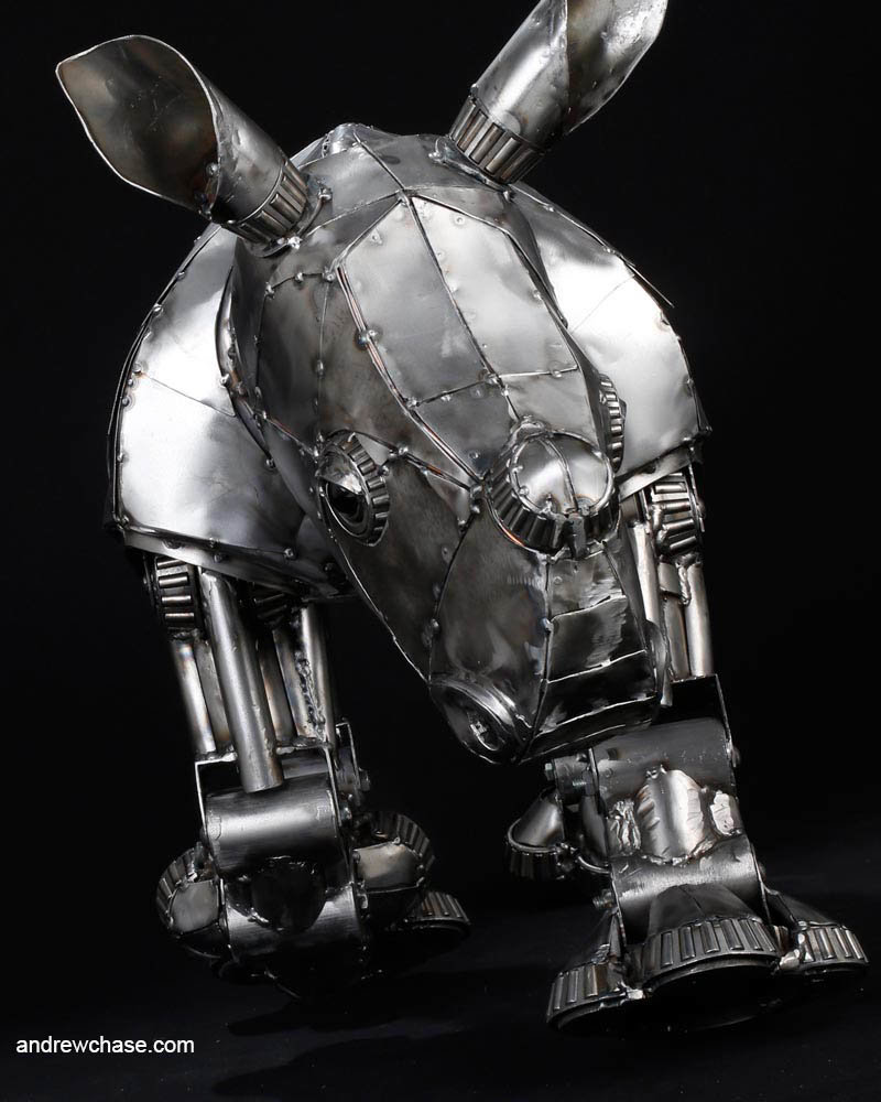 Andrew chase baby rhino metal sculpture charging