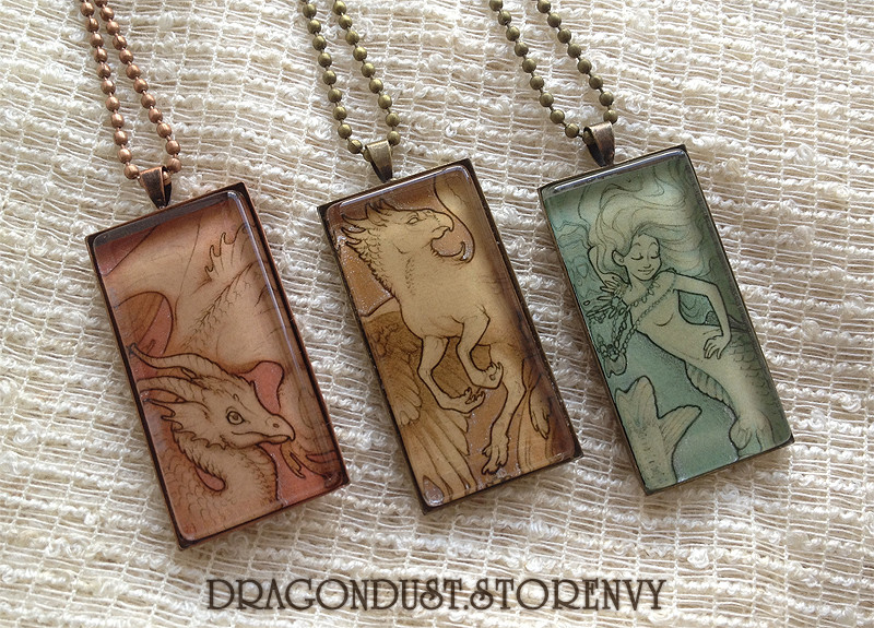 Final hand-embellished glass tile pendants.