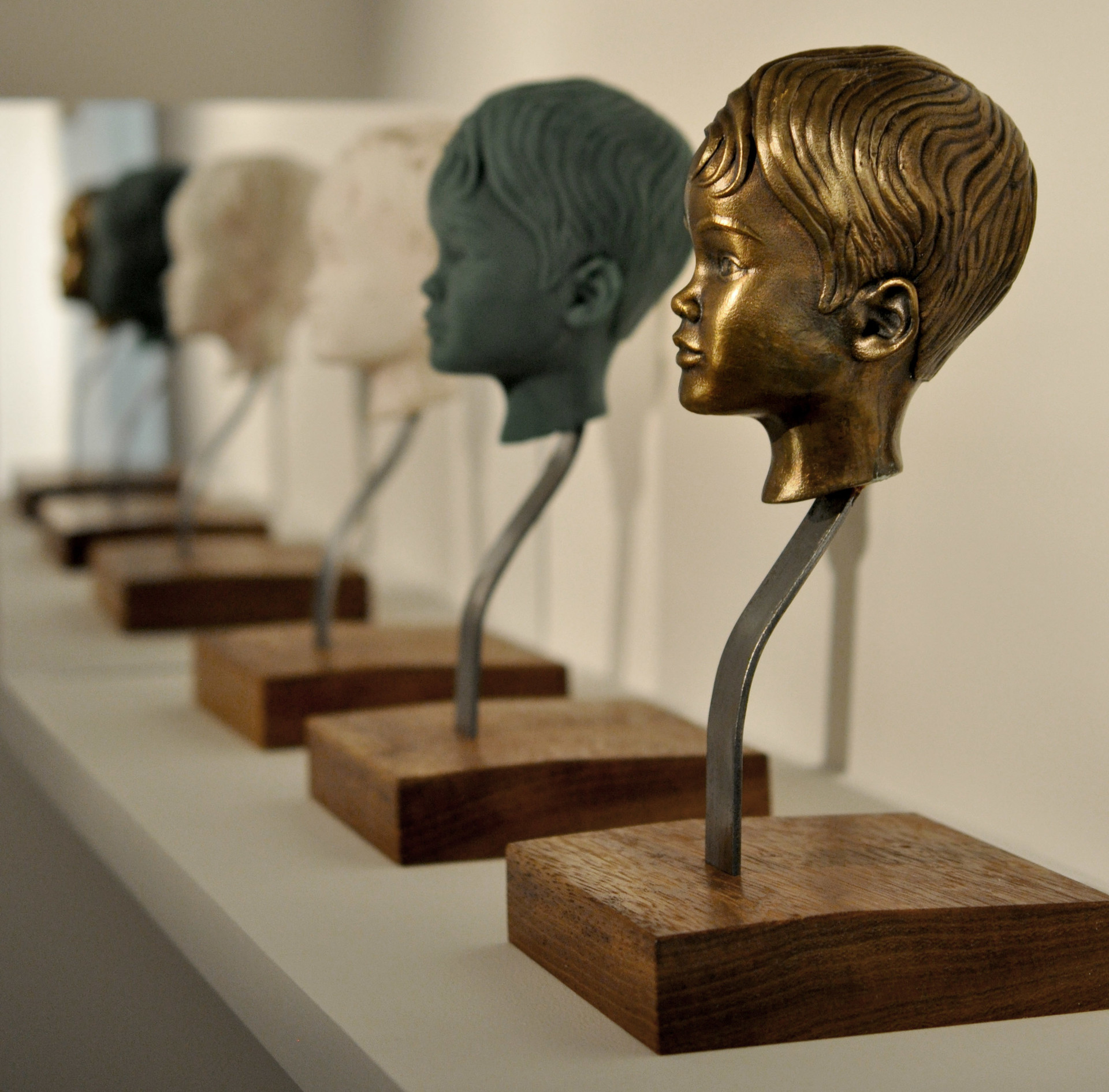 Bronze, wax and 3D printed variations of bust.
