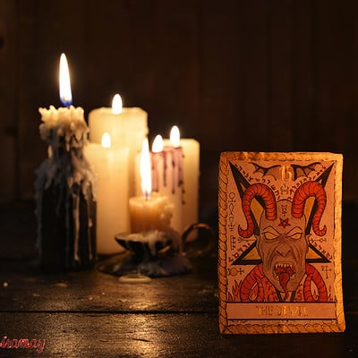 Vera petruk samiramay the tarot card of the devil with defocused candle background