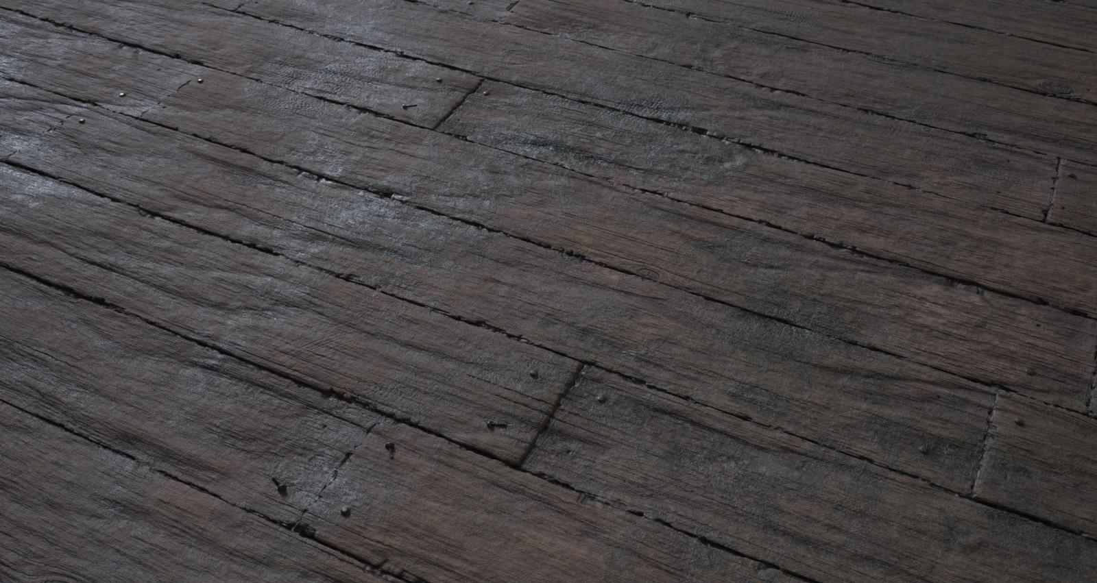 Moist, rotten wood floor with screws.