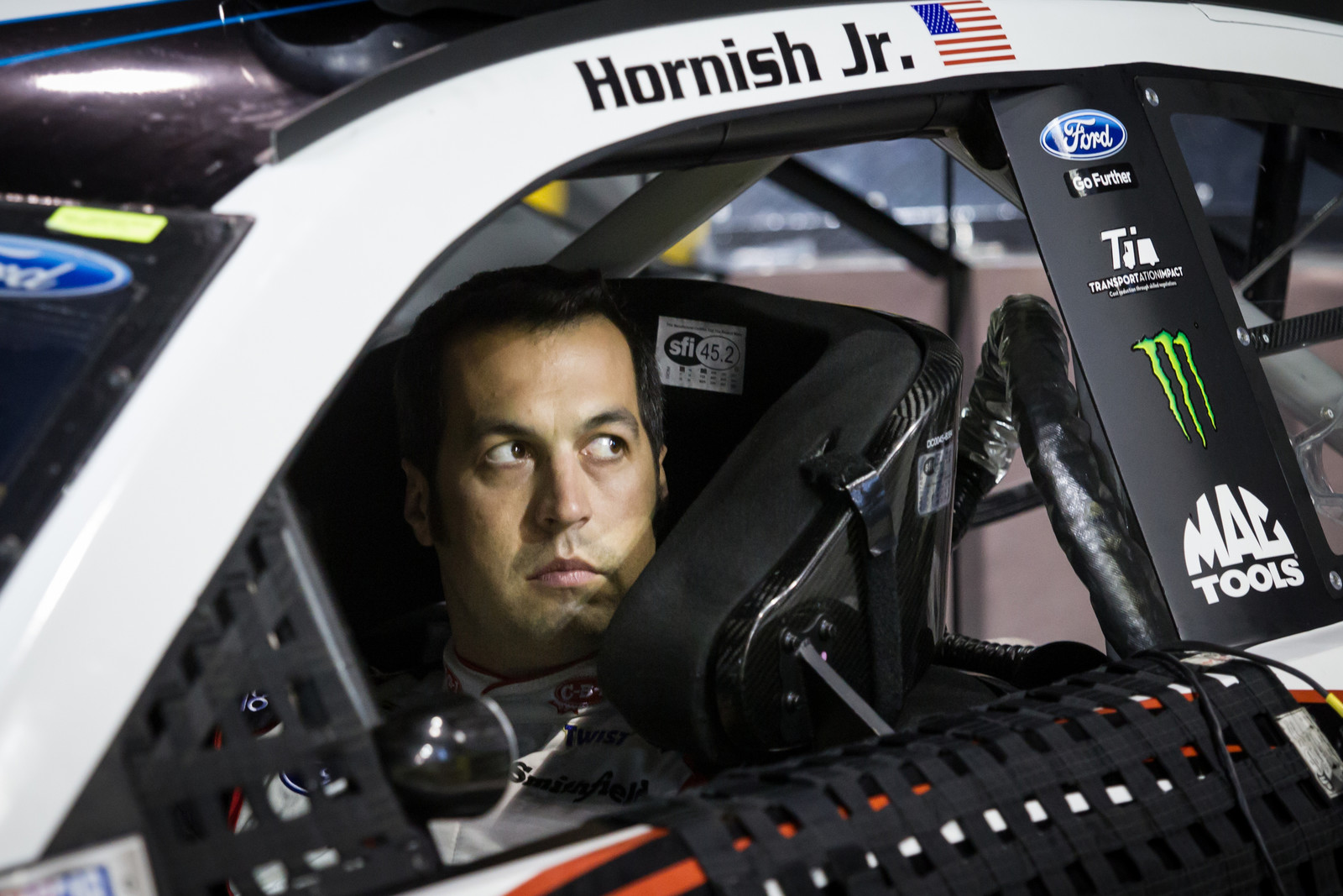 NASCAR Sprint Cup Series driver Sam Hornish Jr. straps into the Cheney Brothers Ford Fusion before the start of the Ford 400 at Homestead-Miami Speedway on November 22nd, 2015