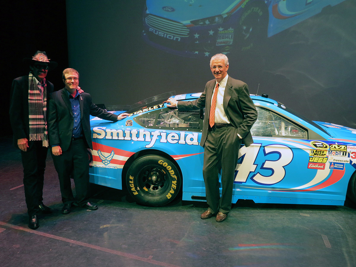 Posing on stage with team owner Richard Petty and Robert C. Weber, Senior Director of Business Development at Smithfield Foods. January 15th, 2014.