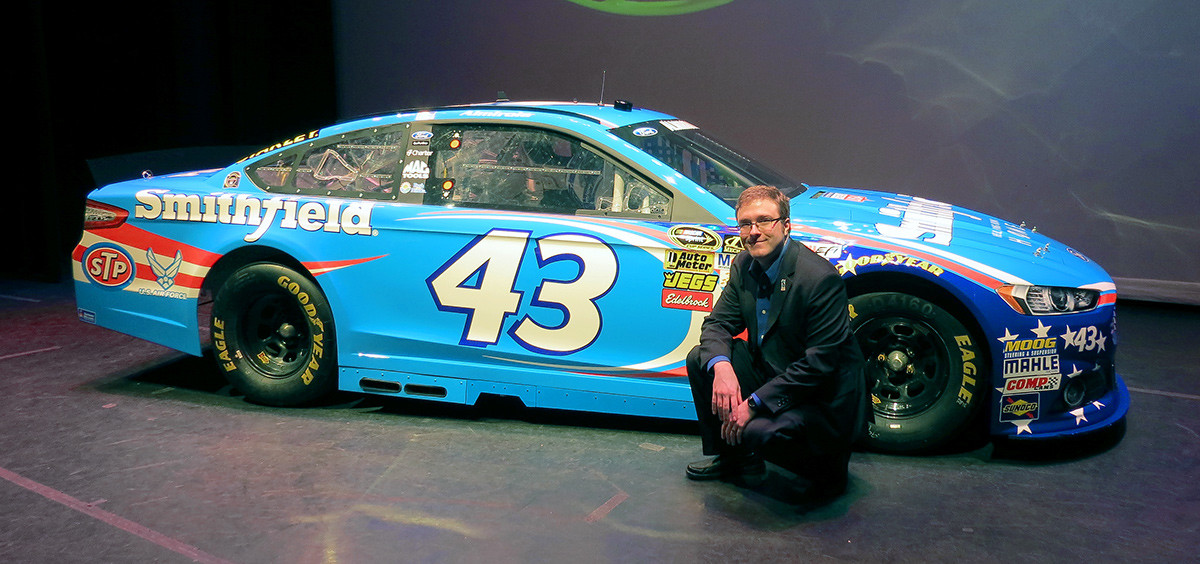 Posing with the 2014 #43 Smithfield paint scheme on stage after it's debut during a live televised event at the Hudson Theatre in New York City.