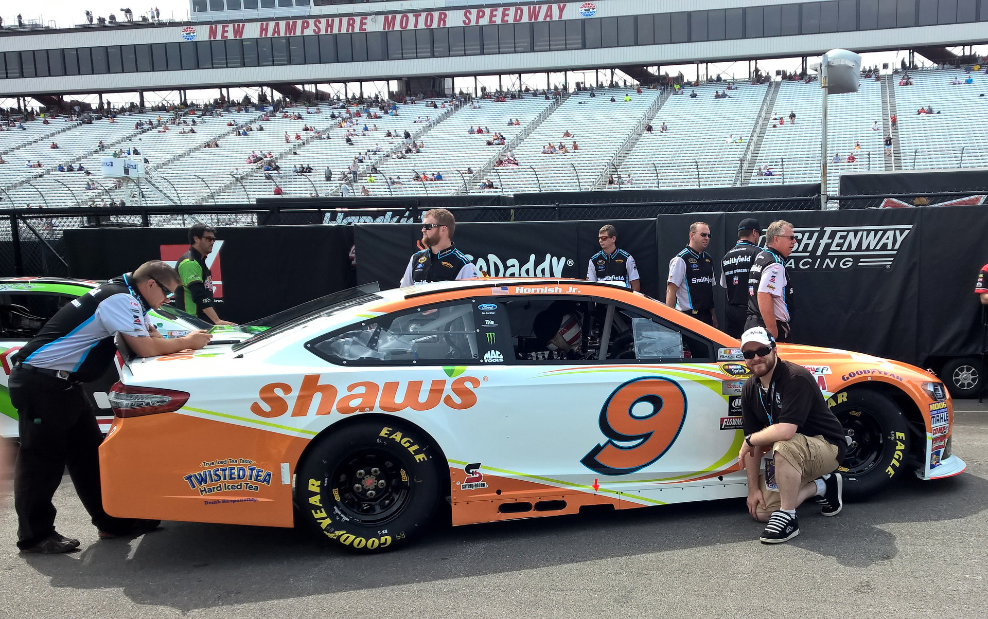 Posing with the #9 Shaw's Supermarkets Ford Fusion in the garage at New Hampshire Motor Speedway on July 17th, 2015.
