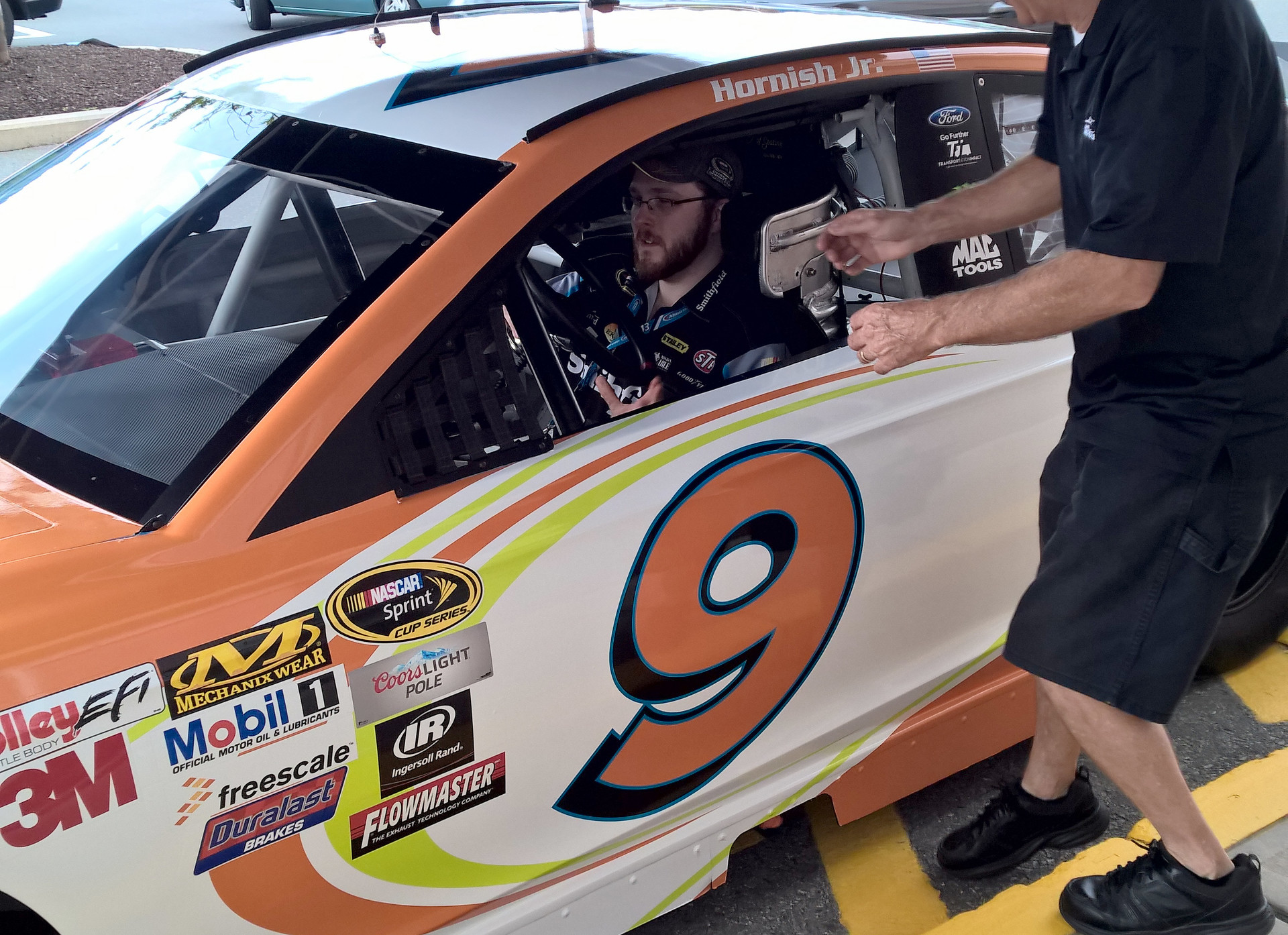 Posing from the driver's seat of the #9 Shaw's Supermarkets Ford Fusion during an appearance event at Shaw's of Concord, New Hampshire on July 18th, 2015.