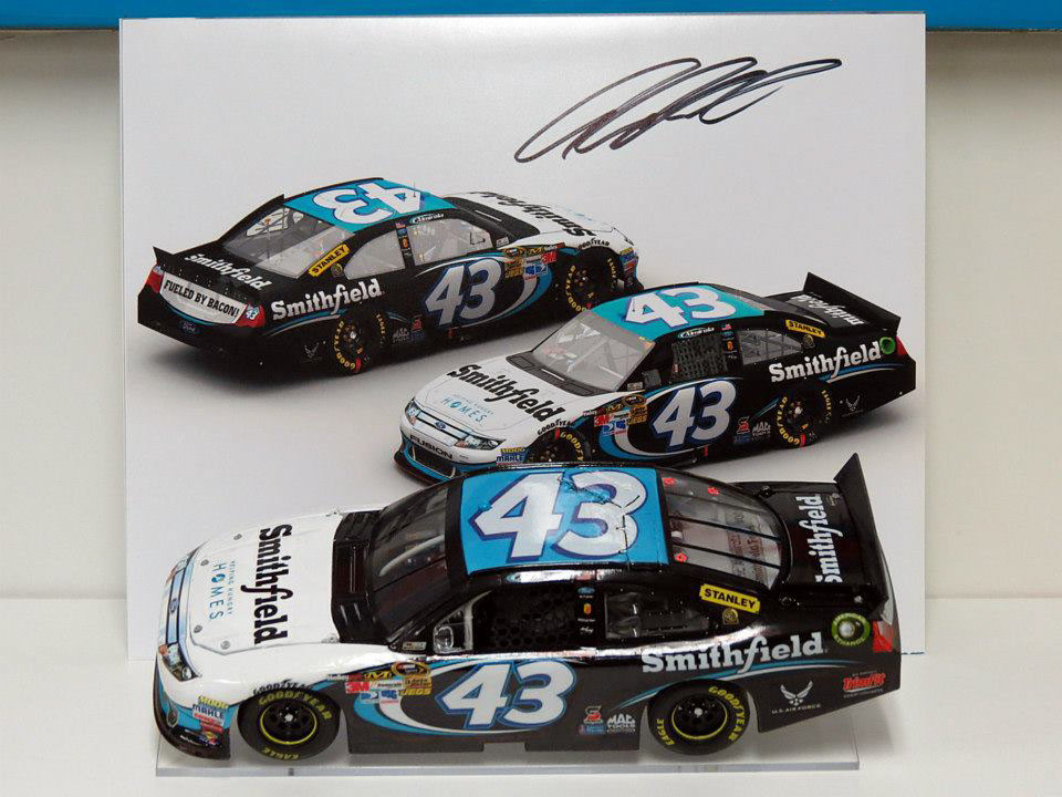 My own personal custom 1/24th scale 2012 #43 Smithfield diecast car along side an autographed copy of my original render for this scheme