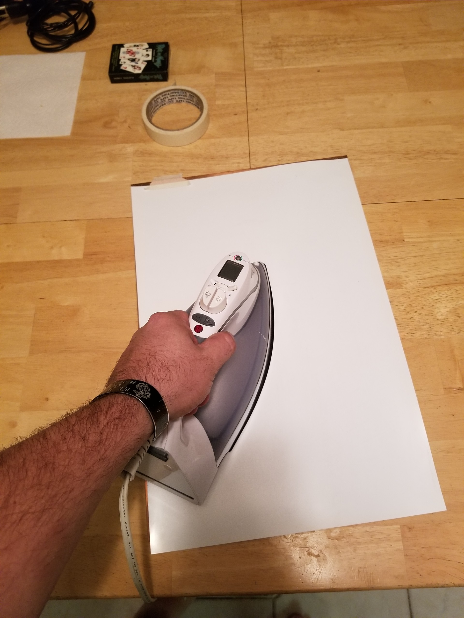 Ironing the back of the mylar sheet for approximately 5 minutes.