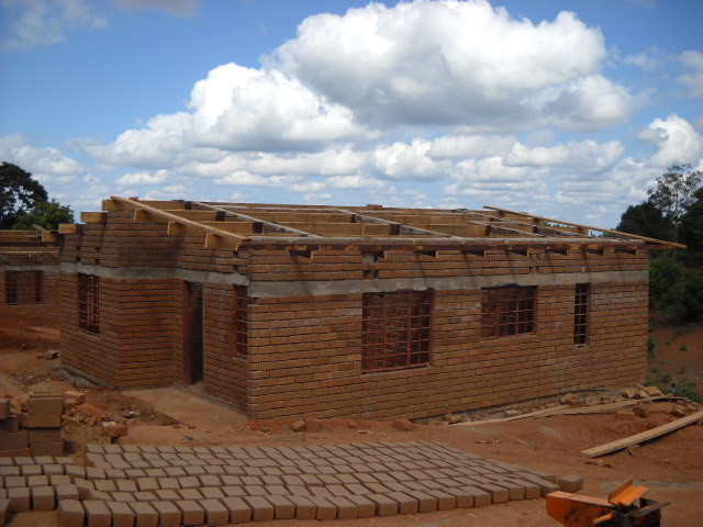 Construction in progress.  Locally made bricks drying in the sun, foreground.