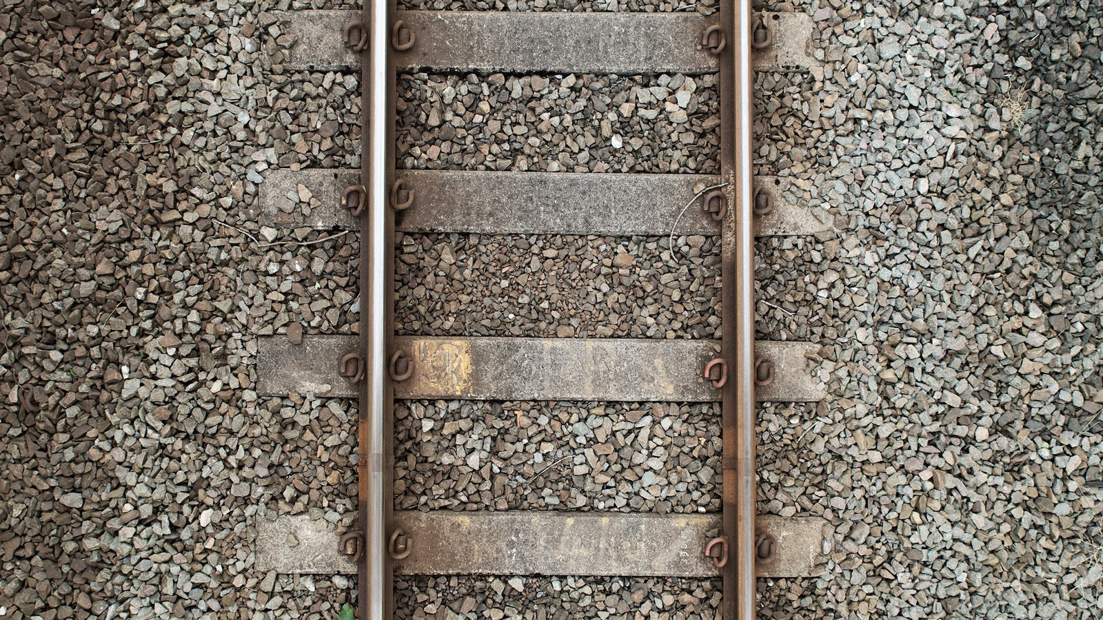 Reference from https://w-dog.net/wallpaper/stones-rails-railroad-top-view/id/336788/