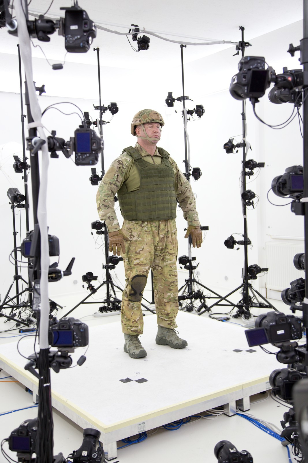 Step 1: Simmer Rich the actor for one hour under the bright bulbs of an evenly-lit room. Dress the actor according to taste. Be sure to rotate and regularly change the configuration of his gear until you are happy with the resulting photos.