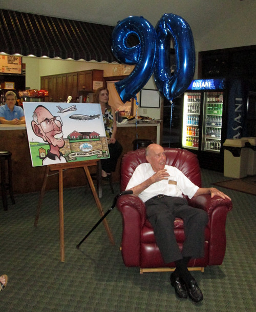 The birthday boy with the caricature.
