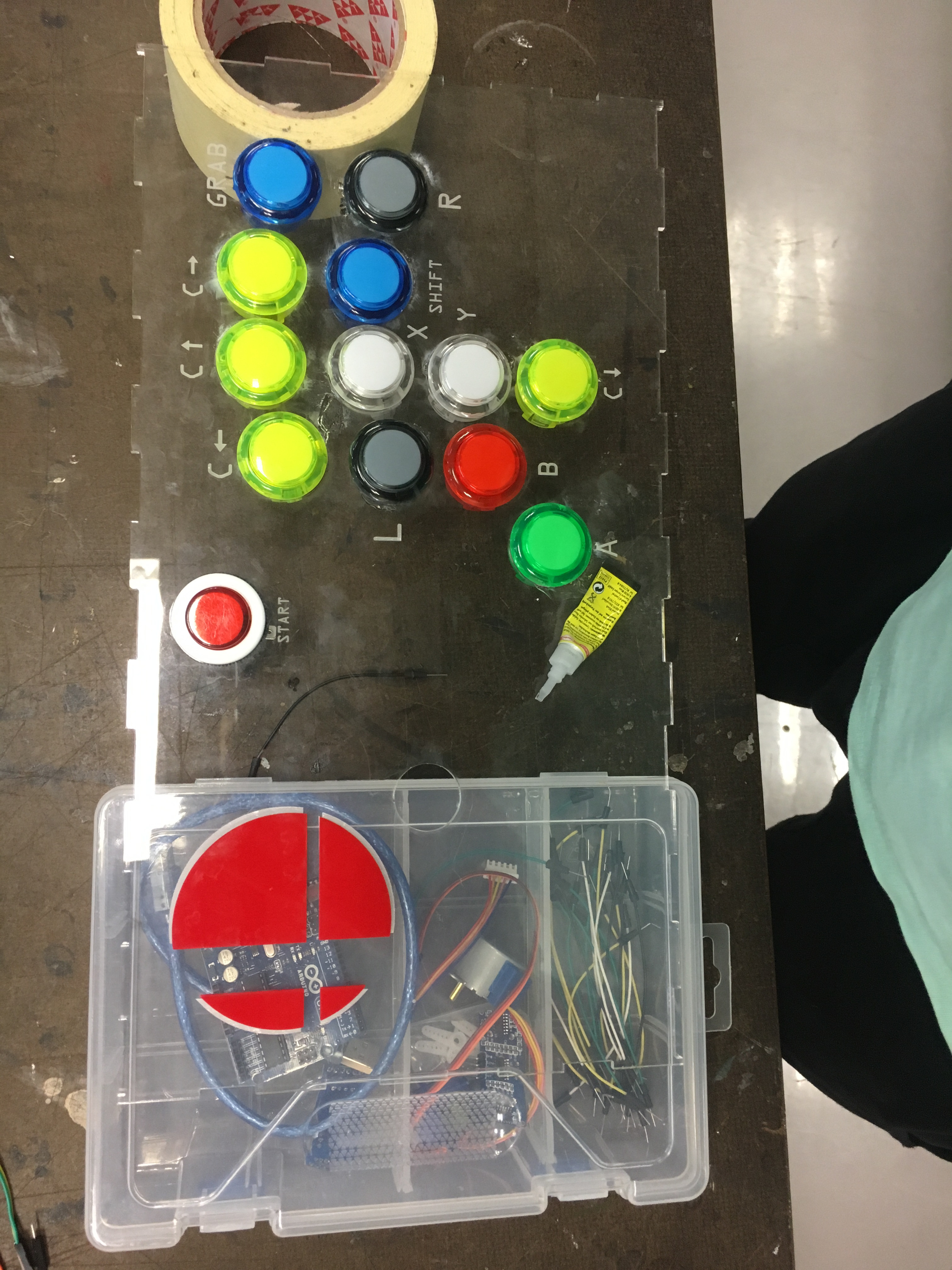 Next I added in the buttons to the faceplate to see what it looked like. Each button goes to a button on a gamecube controller. I went through a few different button layouts before deciding on a final design.