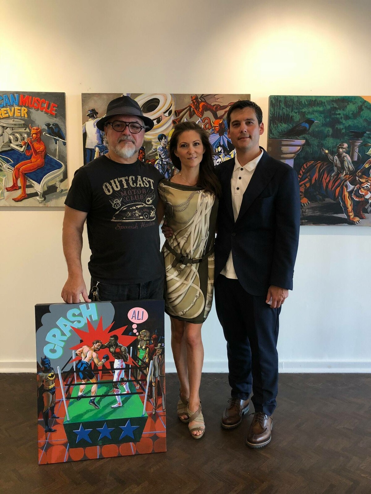 Rachel and Edward McQuillan, proud owners of a new  painting. Art exhibition at the Genua gallery  at Designers Walk, Toronto.