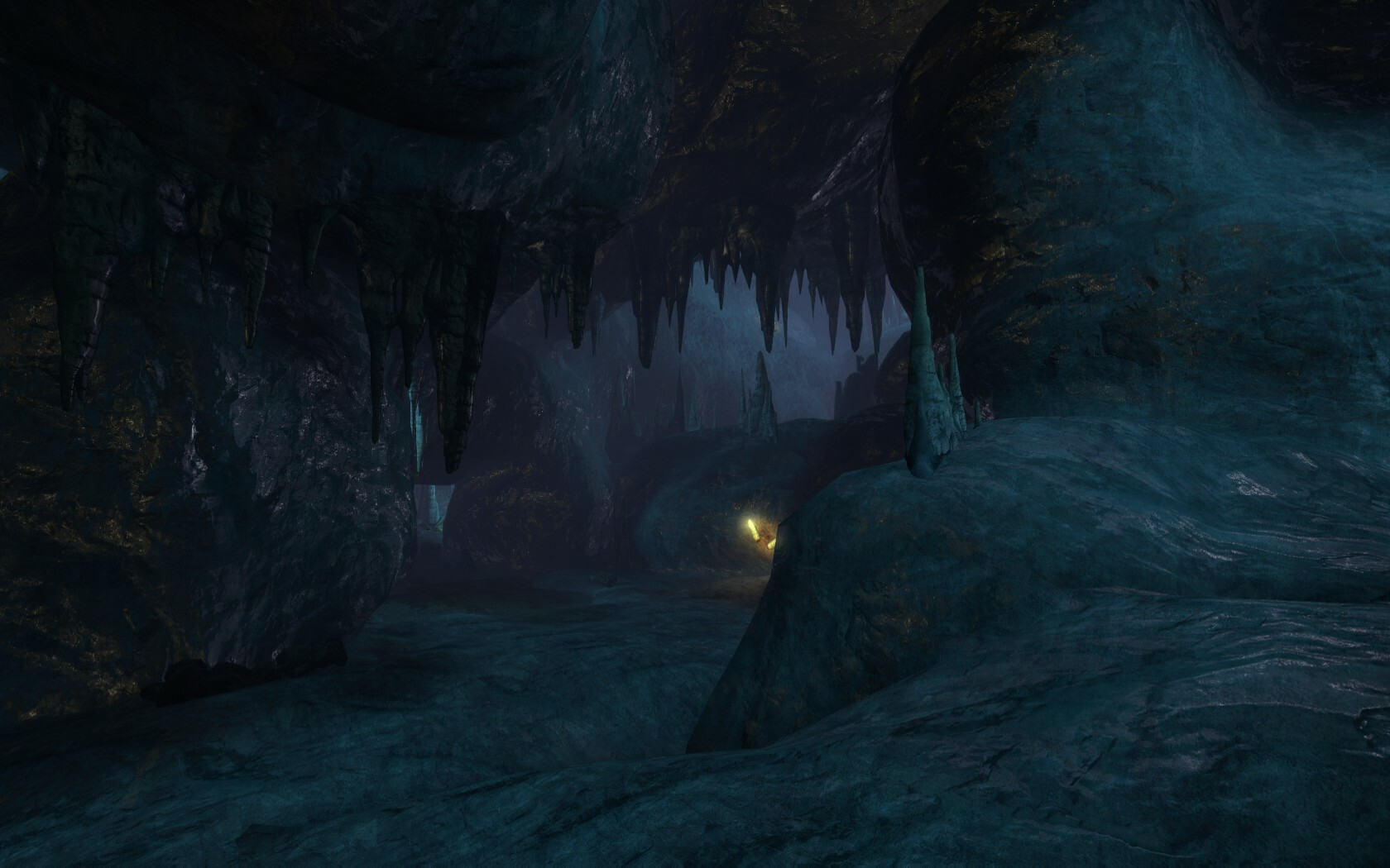 In this scene, the cave extends beyond the current area to add more scale to the cave.