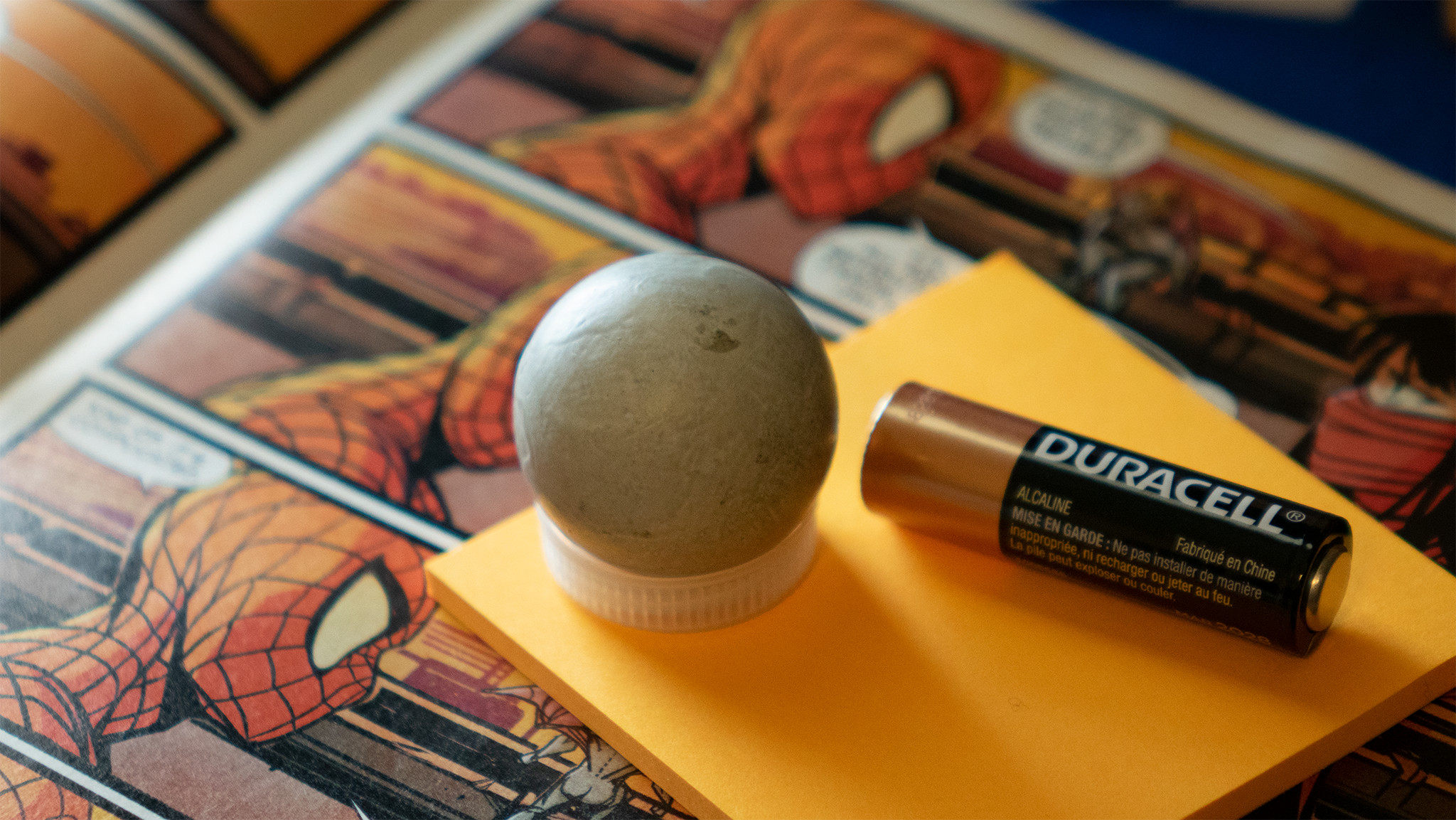 Grey ball, used to match key light. Captures light position and color.