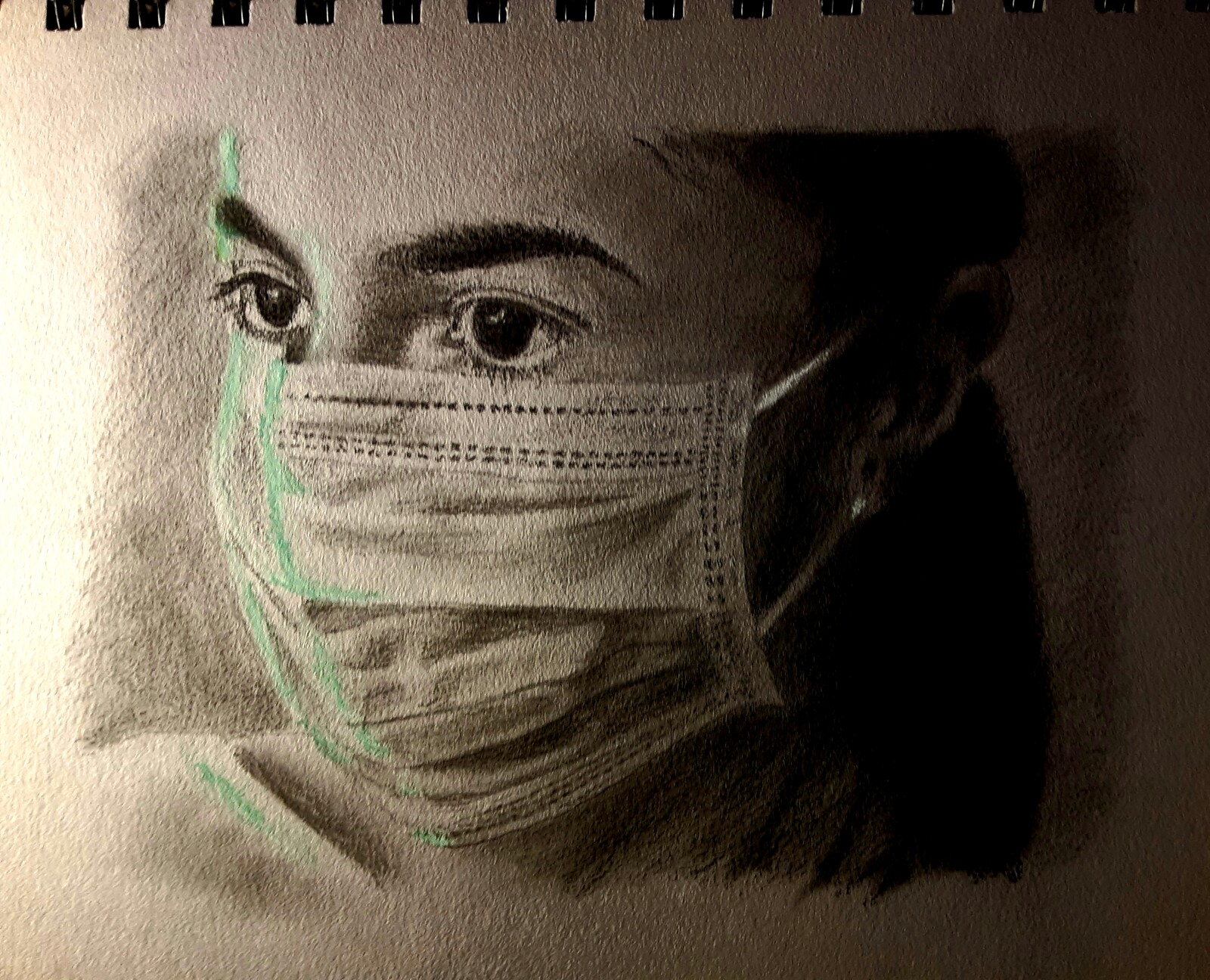 Charcoal sketch of a woman in a mask