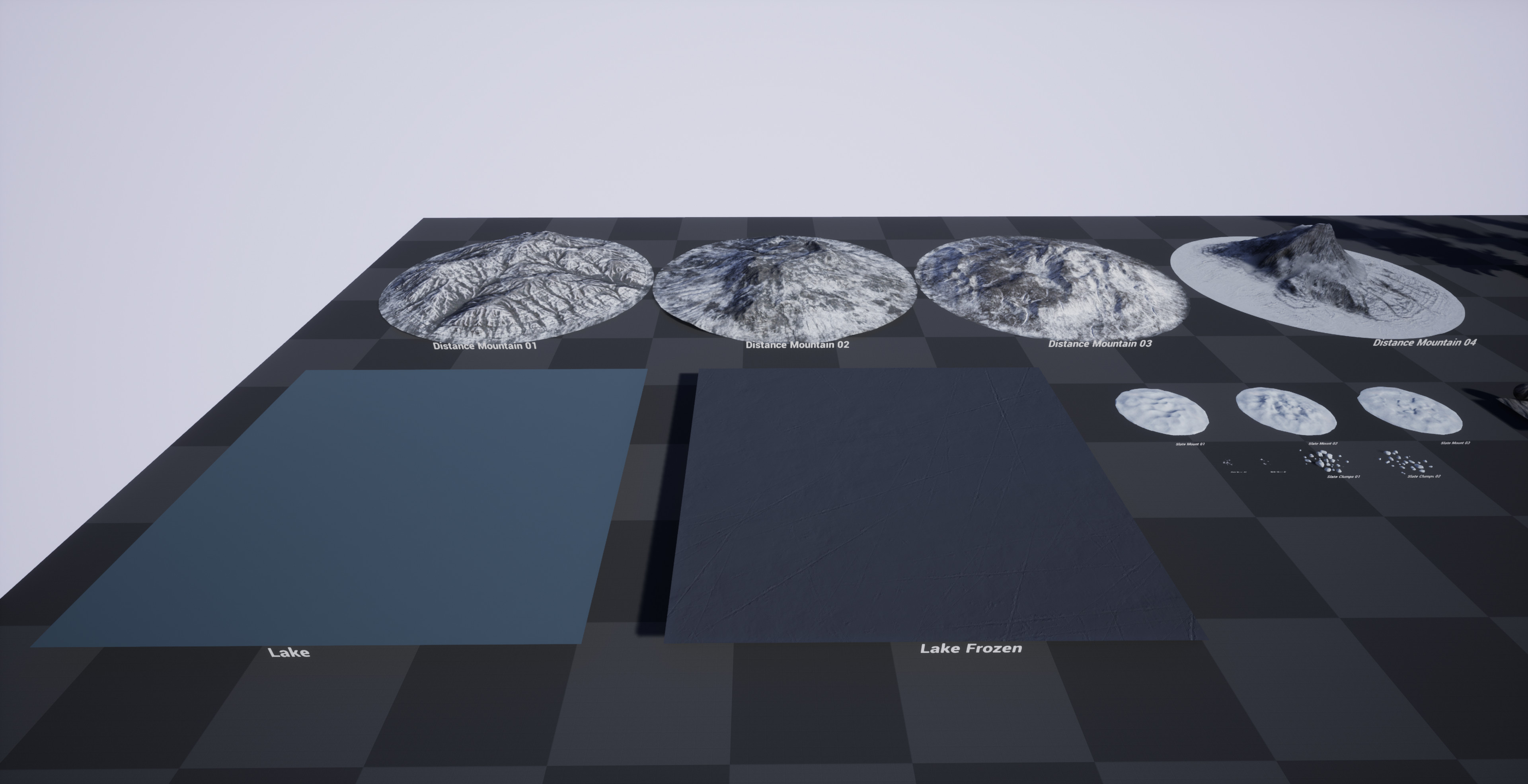 Distance mountains and lake/frozen lake surfaces.