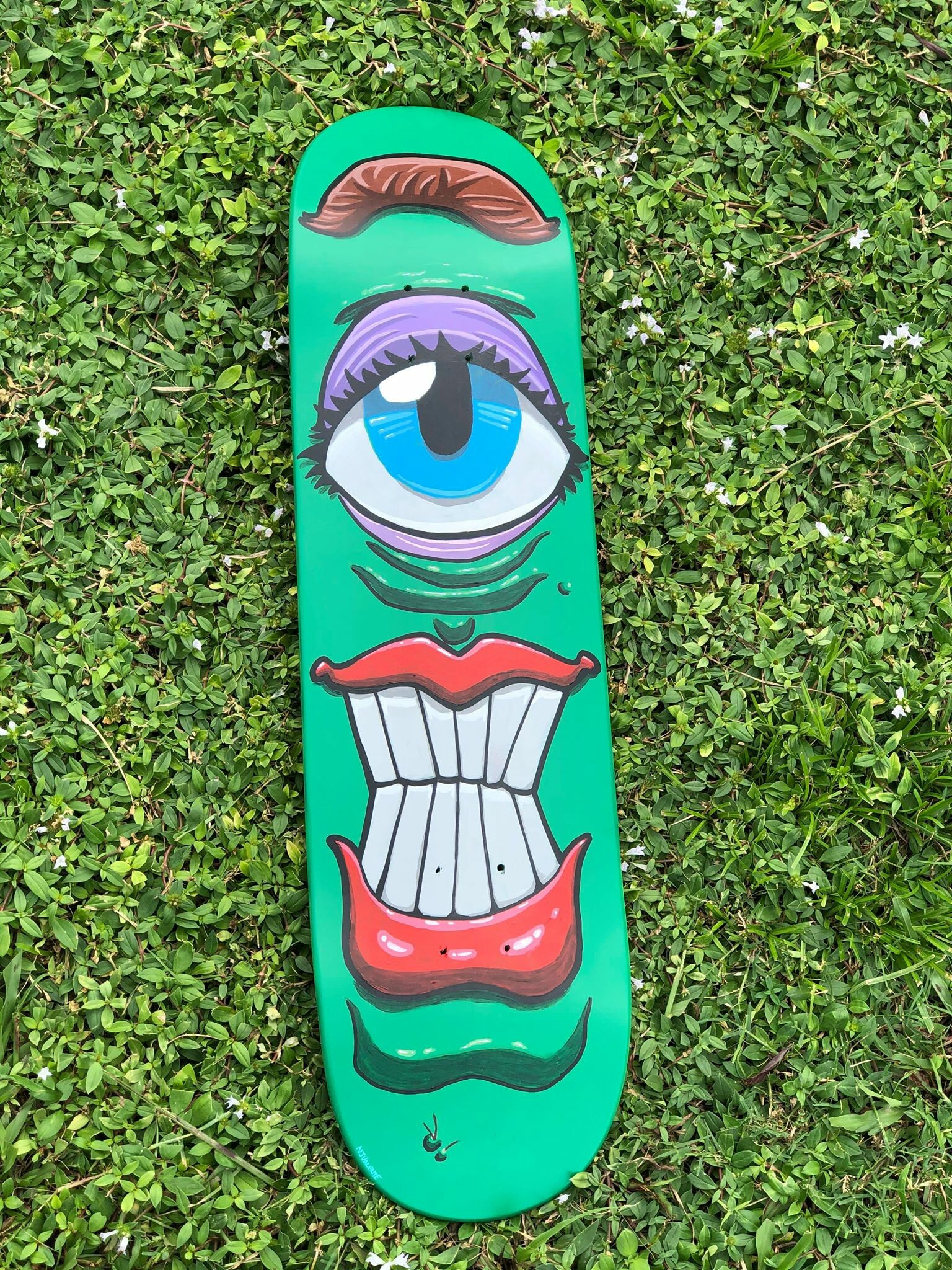 Hand painted with acrylic paints and paint markers.