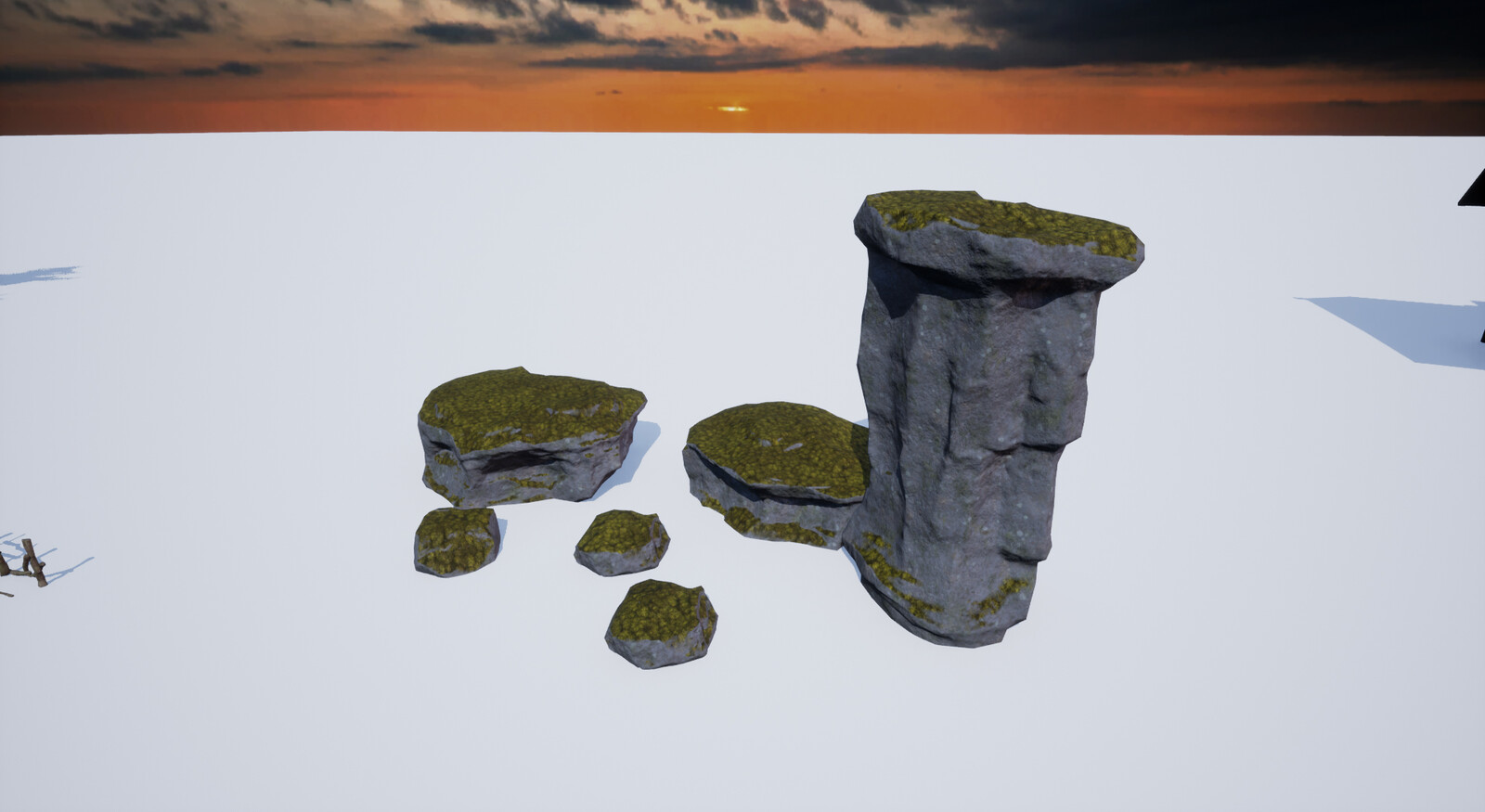 All stones have the same material with an vertex blending shader for the moss.
