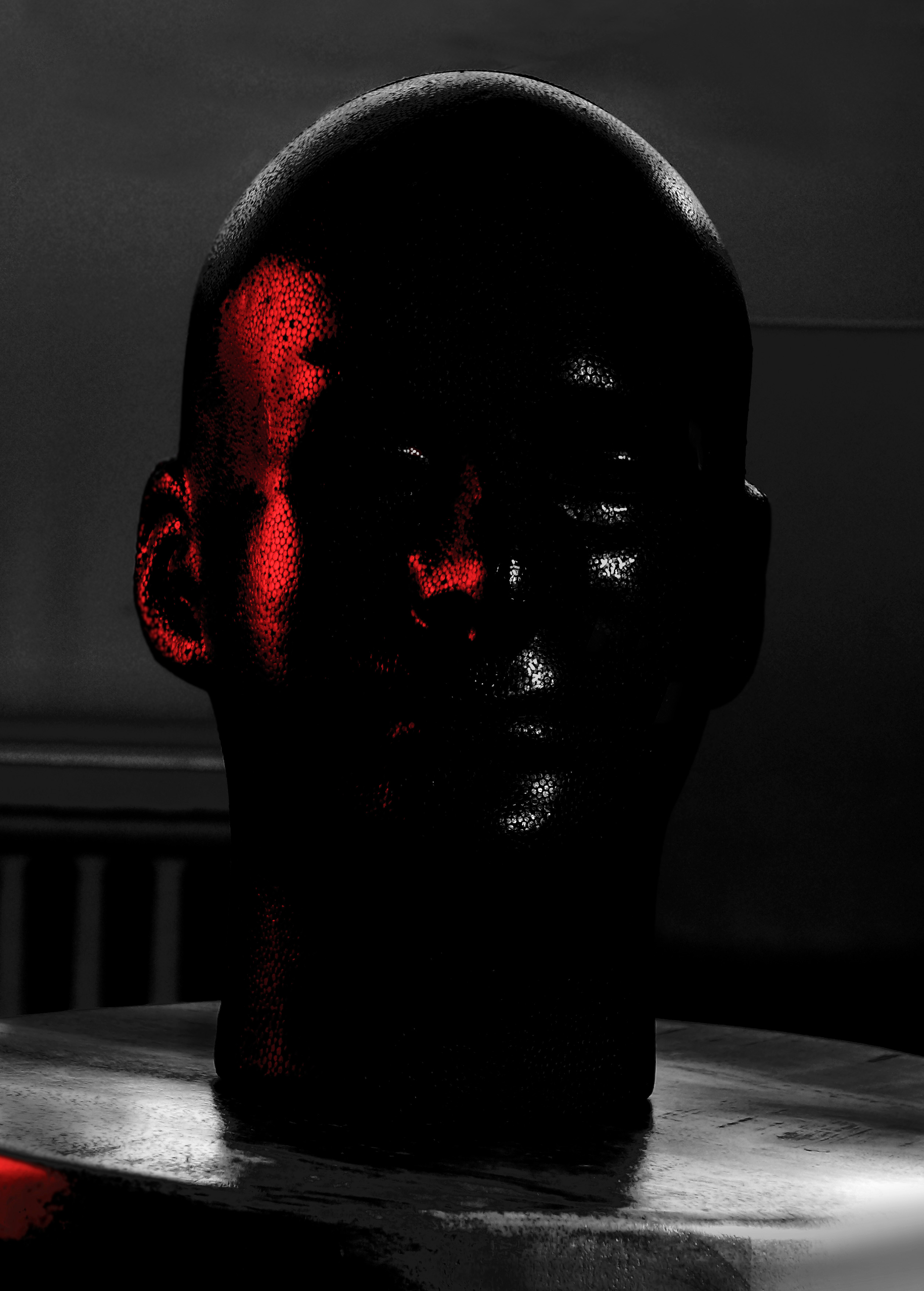 Photograph of a the manikin head demonstrating the  placement and properties of  of the highlight and the reflected light. Created by Vince Mancuso