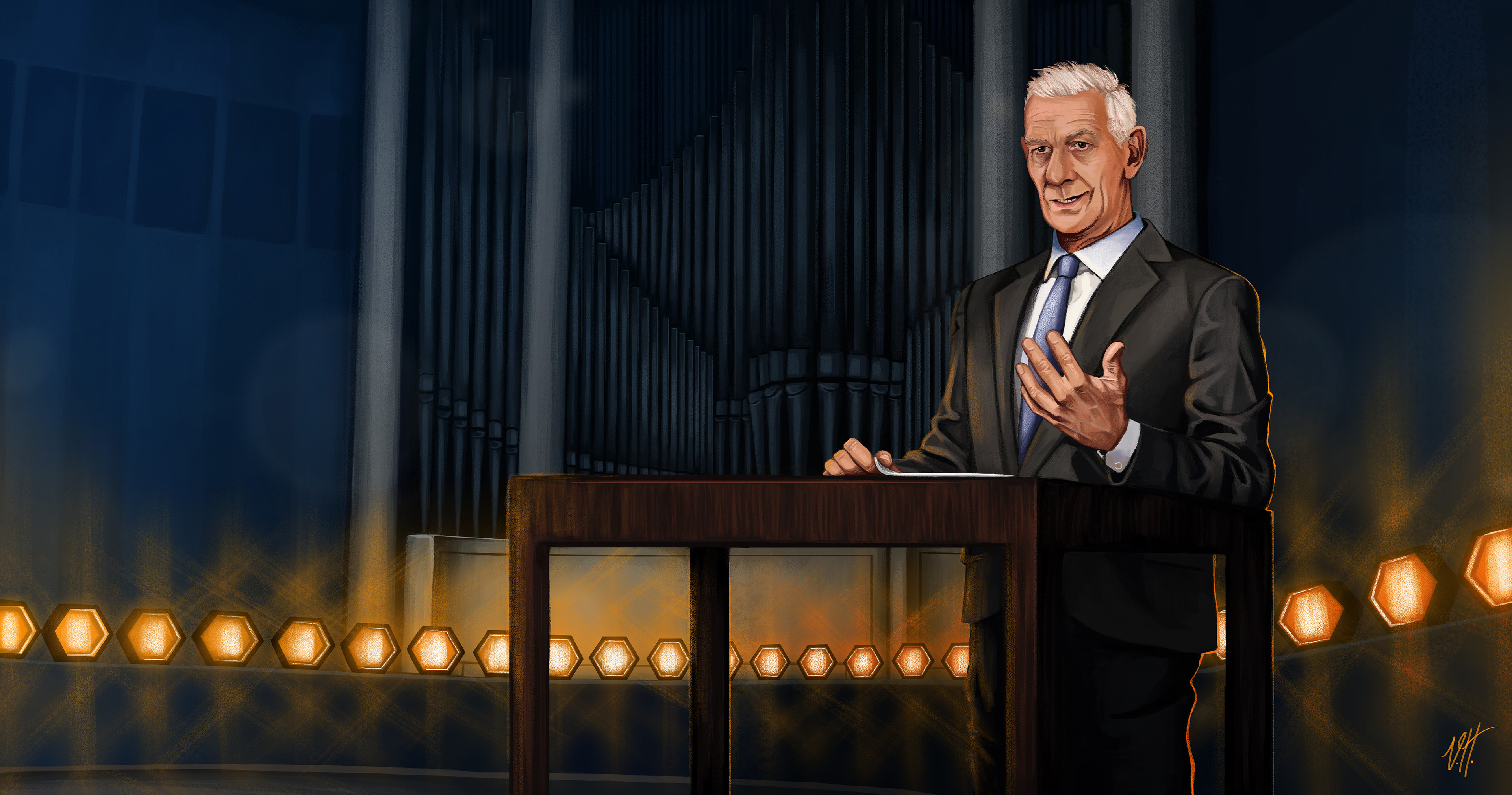 The moderator is giving a talk in front of the organ on stage.