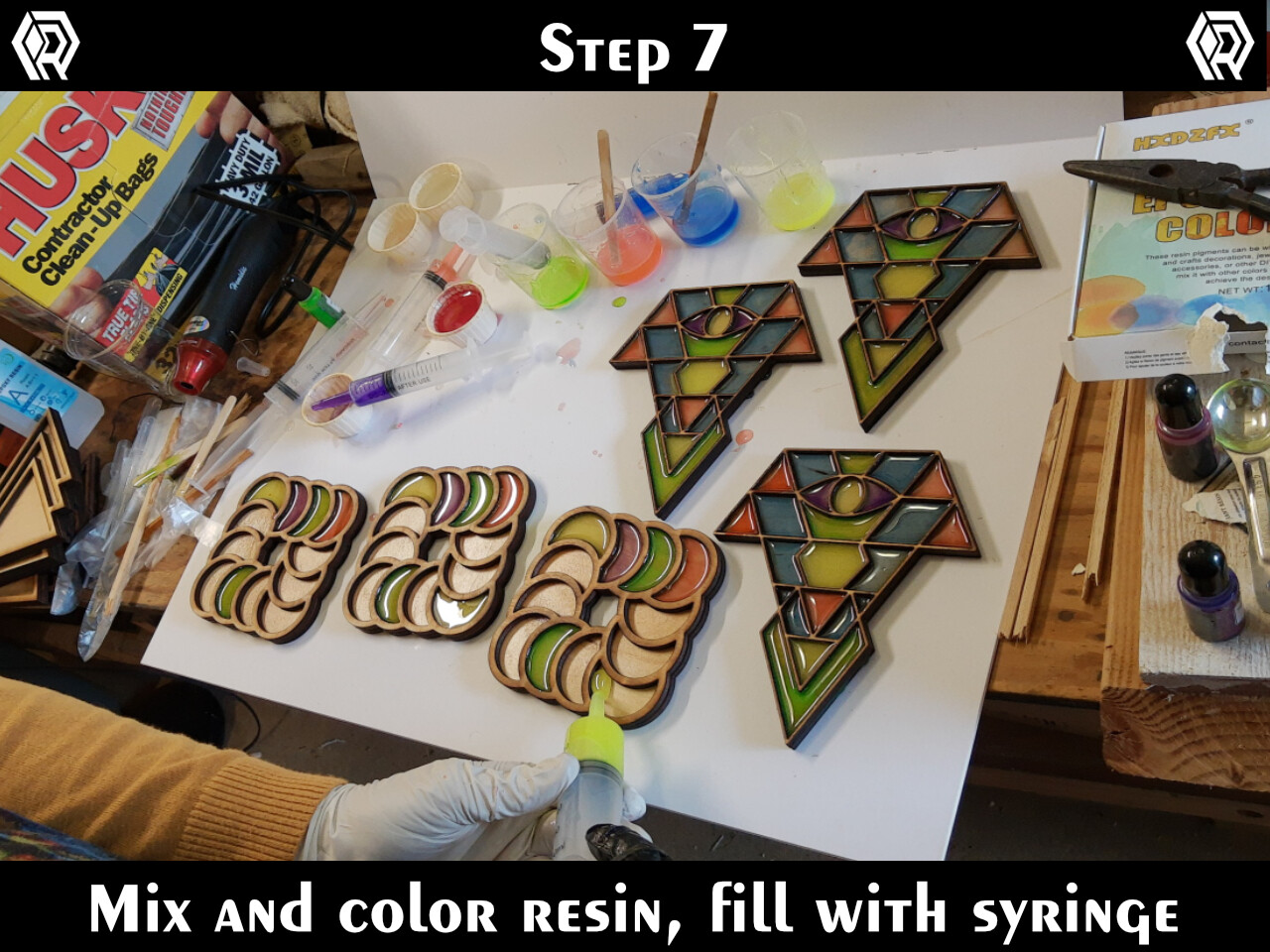 Plan your color scheme, mix your resin, color it, draw it into a syringe, then carefully fill the sections of the art.