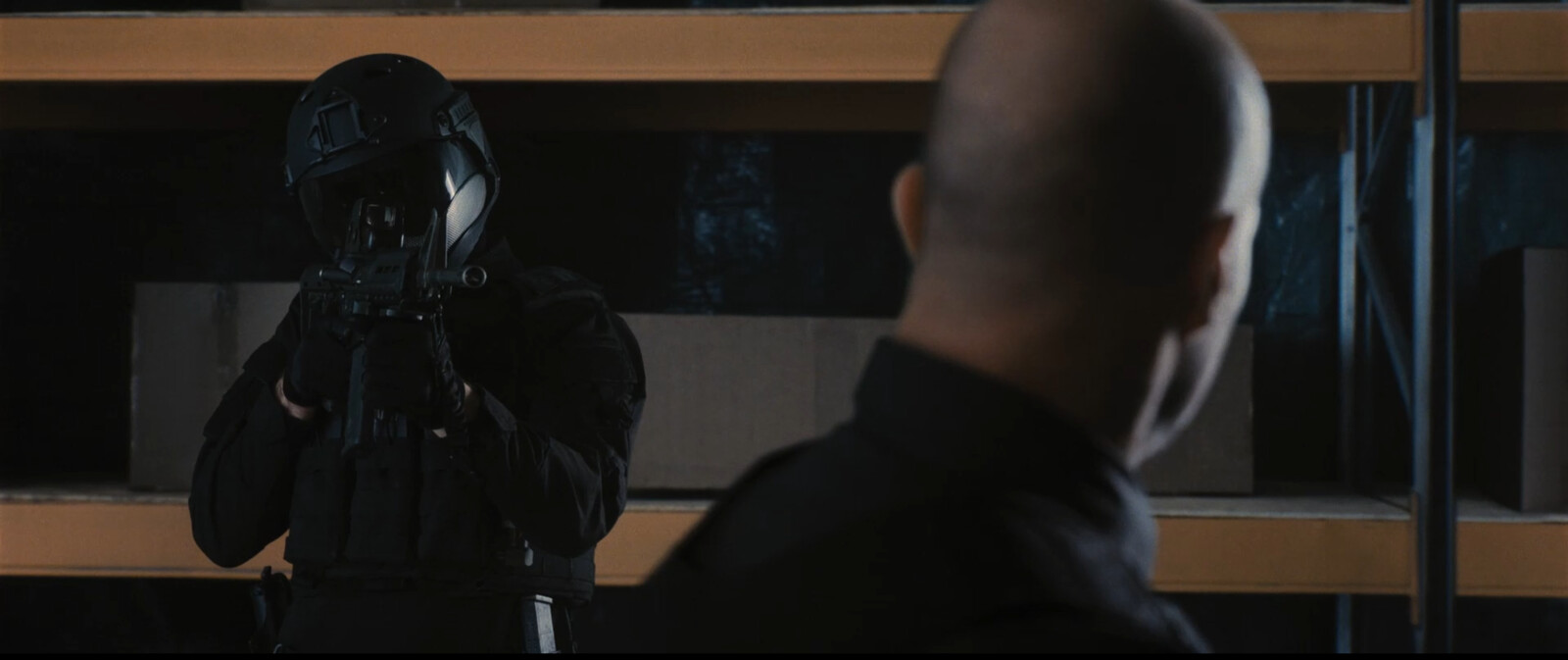 Shelves on Statham's right. Microscopic and precise use of clone brush.
