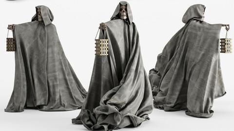 Statue Of A Skeleton In A Cloak