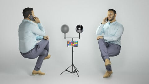 Man in shirt sitting and talking on mobile phone 262