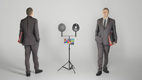 Man in black suit walking with folder 301