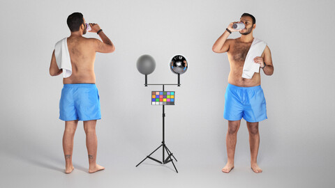 Shirtless young man with towel drinking water 304