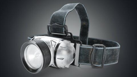 Modern headlamp flashlight on a strap